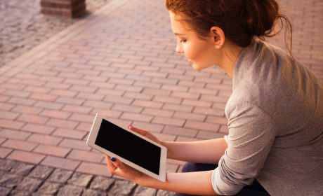 a person reading from a tablet to represent digital learning