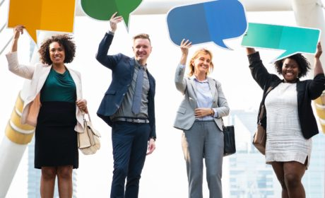 pic of people holding up empty speech bubbles to represent modern performance management